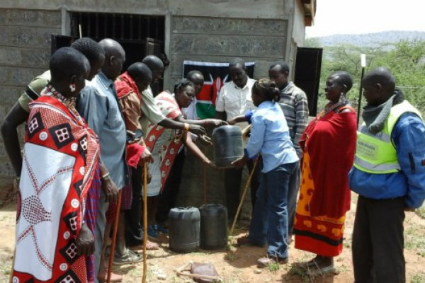 Esther, a member of Nosim women group receives 60 litres of fuel on behalf of the community at the Olelara borehole, Kajiado County