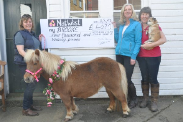 MFP accepts cheque on behalf of Brooke at Wilmbledon Stables