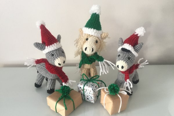 Crocheted donkeys with Christmas hats and scarves