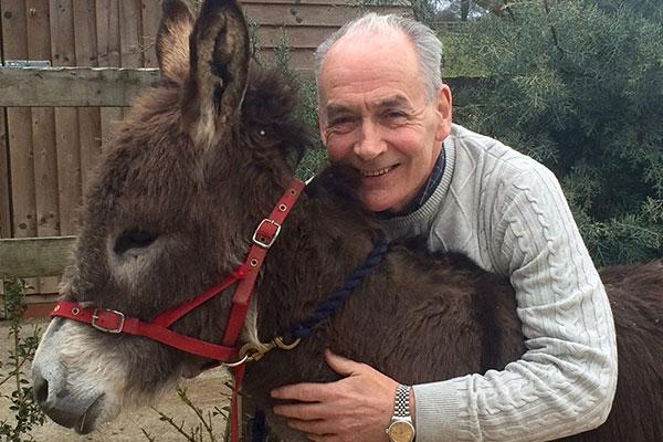 Alastair Stewart with one of his donkeys, Hobnob