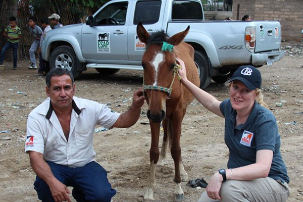Global Animal Welfare Advisor Jen Wathan with Lester Lemus, Project Assistant and Handler at ESAP
