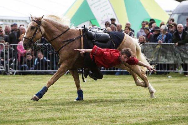Devil's Horsemen rider on side of horse
