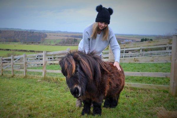 Author Hannah Russell giving Little Alf a good scratch