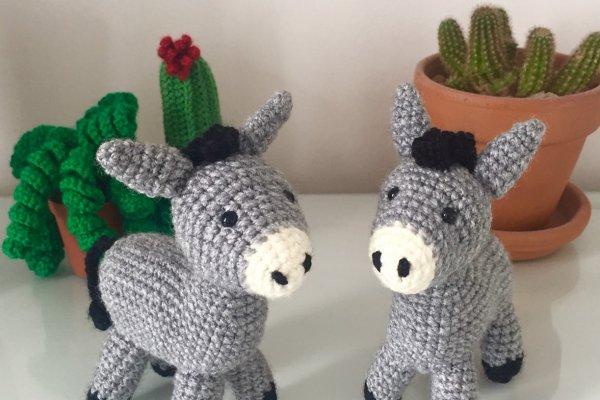 Two crocheted donkeys in grey