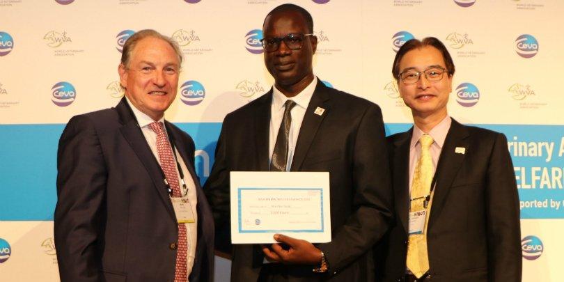 Dr Seck holding his World Veterinary Animal Welfare Award