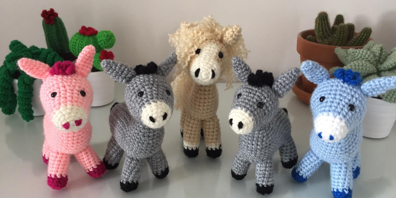 Group of knitted donkeys