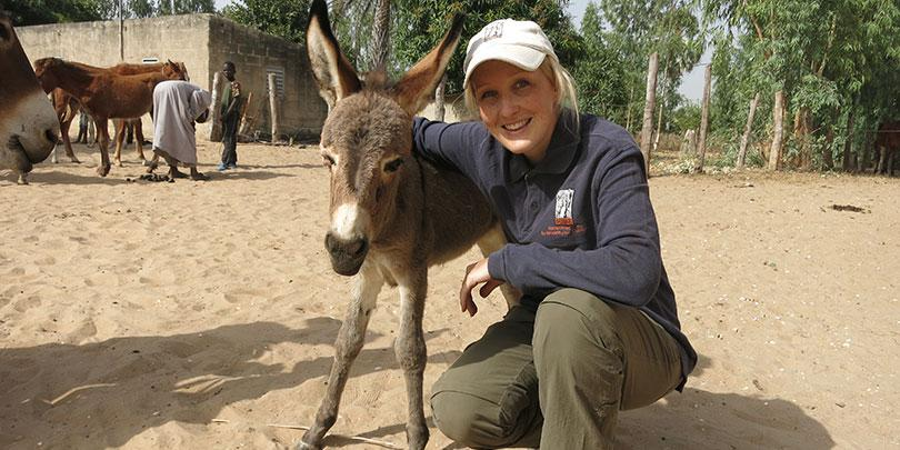 Ashleigh Brown and a donkey in Senegal