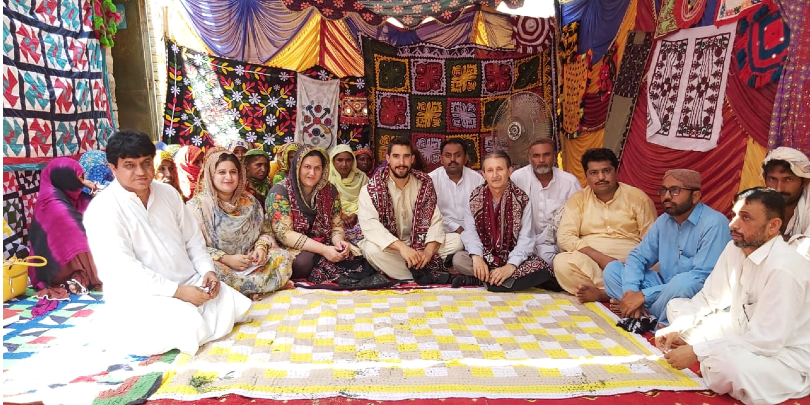 Brooke staff and community members during partner evaluation in Pakistan