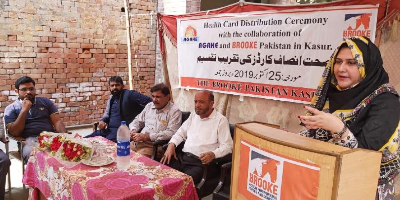 Woman in Pakistan speaking to community members