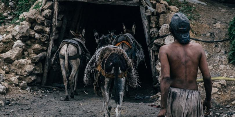 Donkeys entering a coal mine in Pakistan