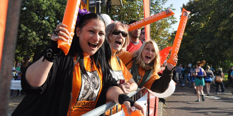Volunteers cheering on our runners at the Royal Parks Half Marathon