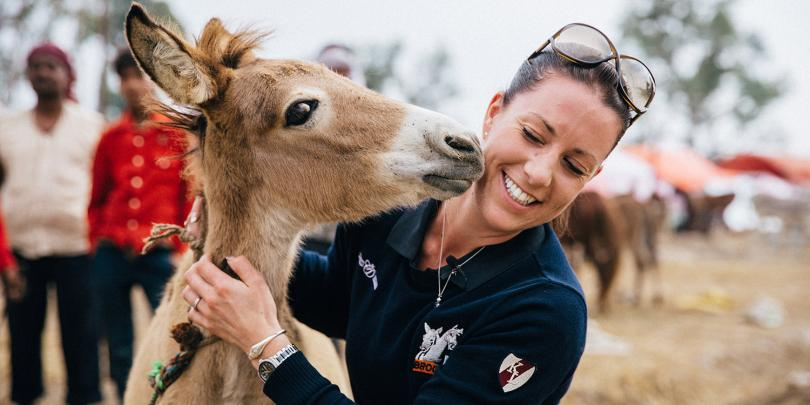 Charlotte Dujardin and a friendly equine in India