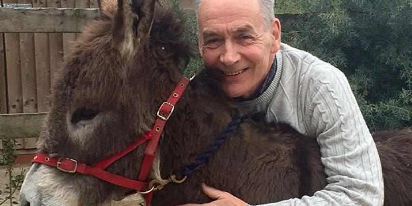 Alastair Stewart with one of his donkeys, Hob Nob