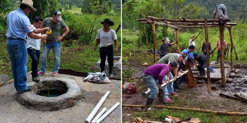 Community members working together to install the water pump