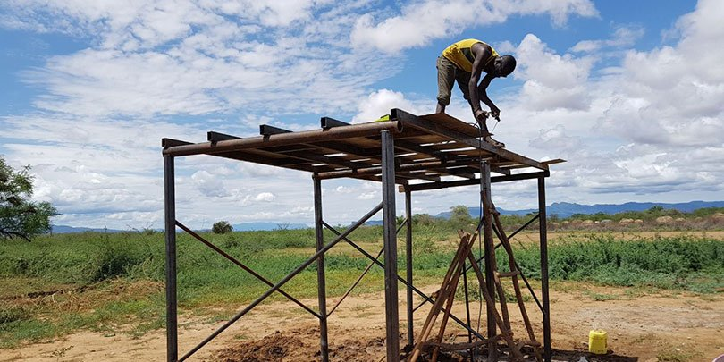Constructing a water tower at Nanam
