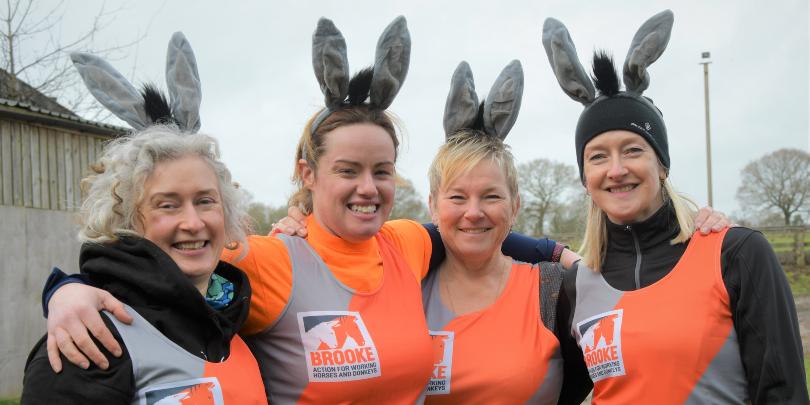 Runners wearing donkey ears