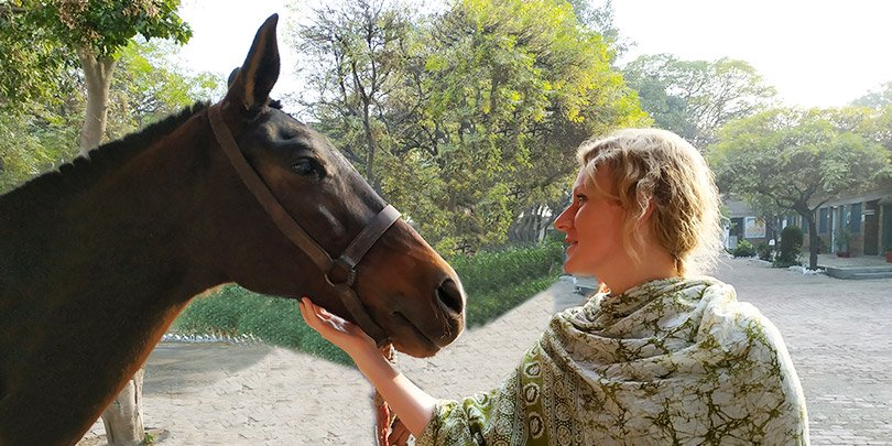 Jen with an equine friend in Pakistan