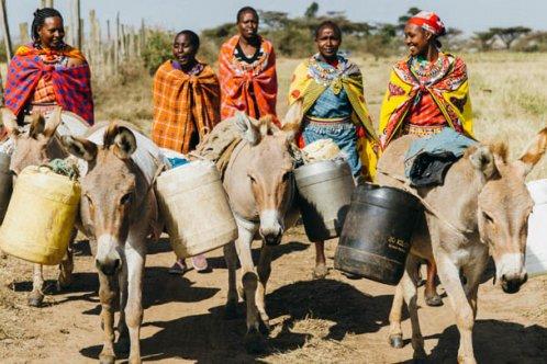 Masai women collecting water