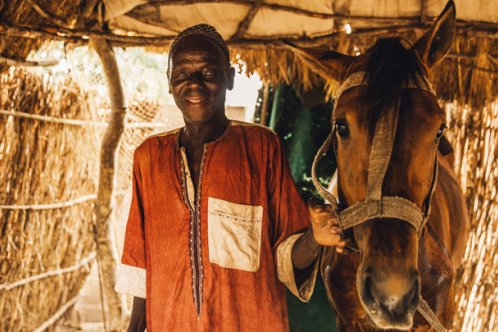 Ablaye Cor with his horse in Badoudou Village, Senegal