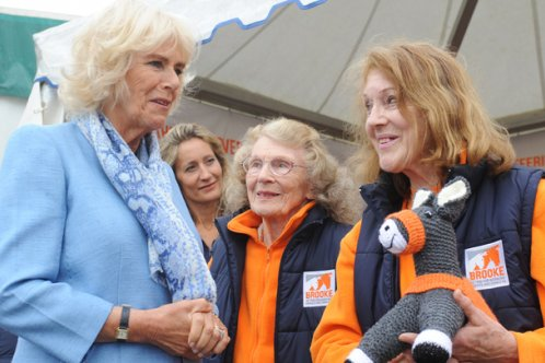 Duchess of Cornwall with three generations of Brooke supporters
