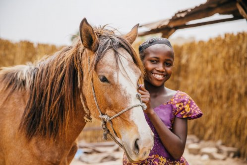 Horse and girl in Senegal, photo by F Dowson