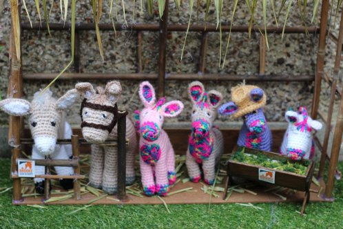 crafted donkeys in a stable