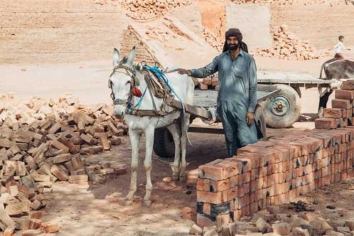 Mohammad working in a brick kiln