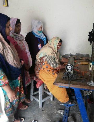 Women in Pakistan make masks