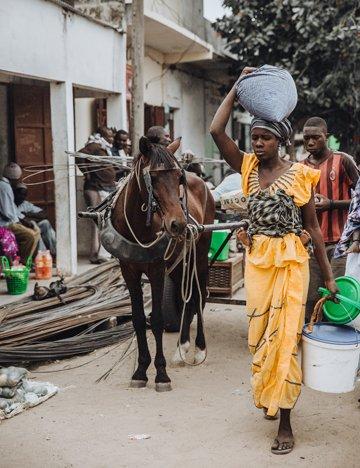 woman carrying grain in Senegal