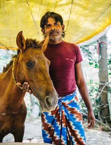 Man with horse in India