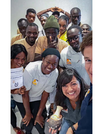 Maïmouna poses for a selfie with Brooke staff during a farriery training in Senegal