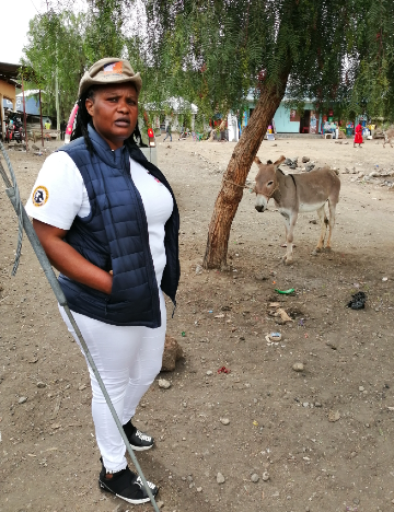 Clemencia with a donkey in Arusha, Tanzania
