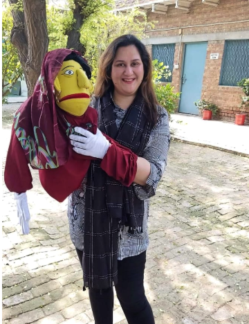 Woman holding a puppet in Pakistan