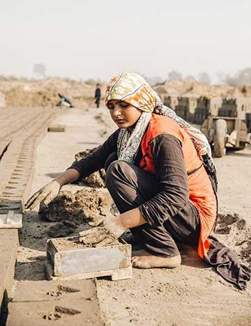 Young woman working at a Pakistan brick kiln