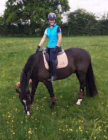 Charlotte Dujardin on a horse in a field
